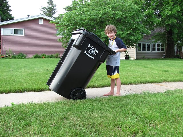 garbage bin and a young boy